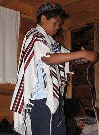 Donning tefillin. Copyright © 2008 Tamu Ngina
